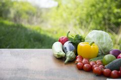 Set of organic vegetables and fruits on rustic wooden table and. Blur background. Copy space Stock Photos