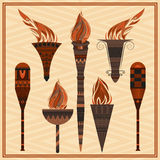 Set  ornamental blazing torches elements  greek ornament, fire. Set of ornamental blazing torches on the sandy background. Elements of greek ornament, fire for Royalty Free Stock Image