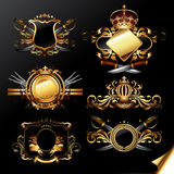 Set of ornamental golden labels. Six ornamental golden labels with weapon,  this illustration may be useful as designer work Stock Image