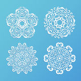 Set of ornamental snowflakes. Indian mandala style. Element for. Design. Round lace. It can be used for decorating of invitations, cards, decoration. Christmas Stock Photos