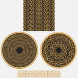 A set ornaments in oriental style.It includes seamless square pattern, two circular mandala and patterned brush. Stock Image