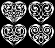 Set of Ornate Heart Shape. Fully editable vector illustration ( EPS) of ornate heart shape set on isolated black background, image suitable for design elements Royalty Free Stock Photos