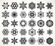 Ornate doodle mandalas. Set of ornate lacy doodle floral round rosettes in black over white backgrounds. Mandalas formed with hand drawn calligraphic elements stock illustration