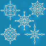 Set of ornate snowflakes against blue background Stock Photography