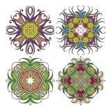 Set of ornate vector mandala symbols. Mehndi lace tattoo. Art Nouveau weave. The circular pattern Stock Images