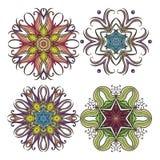 Set of ornate vector mandala symbols. Mehndi lace tattoo. Art Nouveau weave. The circular pattern Stock Photos