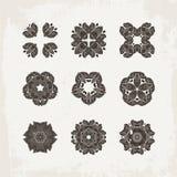 Set of ornate vector mandala symbols. Mehndi lace tattoo. Oriental weave. Stock Photo