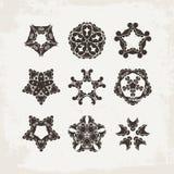 Set of ornate vector mandala symbols. Mehndi lace tattoo. Oriental weave. Stock Photography