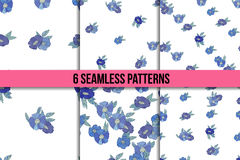 Set osix seamless patterns with blue flowers Royalty Free Stock Images