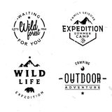Set of outdoor logotypes in vintage style. Retro wild adventures themed labels, badges, symbols Royalty Free Stock Photo