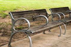 Empty outdoor park benches on sidewalk stock photography