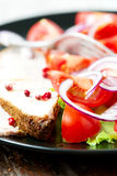 Set of oven baked pork in plate with salad macro Stock Images