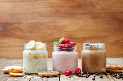 Set overnight oats with berries, coconut, peanut butter, Chia se Royalty Free Stock Image