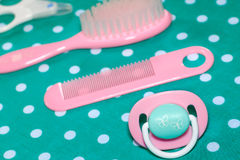 Set of pacifier and brushes Stock Photography