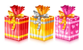 Set of packaged holiday gifts with bow Royalty Free Stock Image