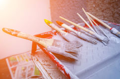Set of paint brush in paint tray Stock Images
