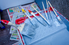 Set of paint brush in paint tray Royalty Free Stock Images