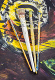 Set of paint brushes. On oil painting Stock Photos