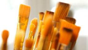 Set of paint brushes close-up. Art studio concept. stock video