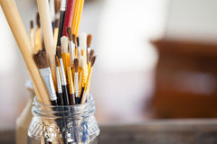 Set of paint brushes in a jar Stock Photo