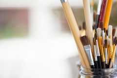 Set of paint brushes in a jar Royalty Free Stock Photo