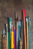 Set of paint brushes and office supplies Stock Photos