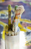 Set of paint brushes on oil painting. Set of paint brushes on jar, on oil painting Stock Photo
