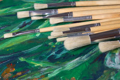 Set of paint brushes on oil paints Stock Photography
