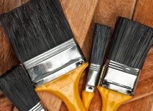 Set of paint brushes on a wooden background Royalty Free Stock Image