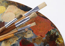 Set of paintbrushes and palette Stock Photos