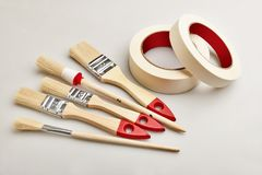 Set of painting brushes and masking tapes Stock Photos