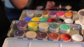 The Set Paints Makeup. Professional multicolored palette brush makeup artist for cinema actor stock video footage