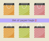 Set of paper bags 2, orange, green, pink polka dots paper bags. Vector illustration. Royalty Free Stock Photo