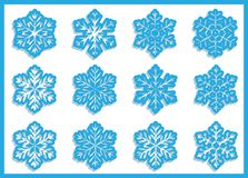 A set of simple varied geometric snowflakes. A set of paper carved varied geometric snowflakes with shadown Stock Photography
