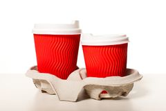 Set of paper cups. Disposable red paper coffee cups  of different sizes standing in a row on a white background, mockup for design for espresso, cappuccino Stock Photography