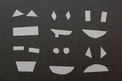 Set of paper smiles on a gray background stock illustration