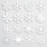 Set of paper snowflakes. Set of white snowflakes various forms made from paper, with shadows Stock Photos