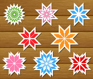 Set of paper snowflakes on wooden background Stock Photo