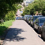 Set of parked cars near the footpath Royalty Free Stock Photos