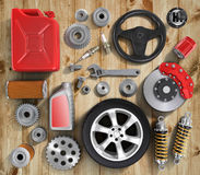 Set of parts of car on wood background. Royalty Free Stock Photography