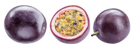 Set of passion fruits and its cross section with pulpy juice filled with seeds. Clipping path. ÑŽ royalty free stock photo