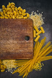 Set of pasta on a dark background. Italian food frame. Place for text or logo Stock Images