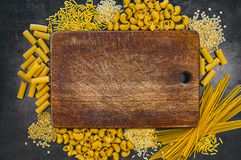 Set of pasta on a dark background. Italian food frame. Place for text or logo Stock Photo
