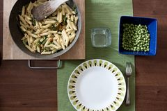 Set of pasta with flowers of zucchini and fresh green pea. Laden with vegan, raw and vegetarian food stock images