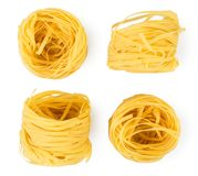 Set of pasta nests on a white. The form of the top. Set of pasta nests on a white background. The form of the top stock photo