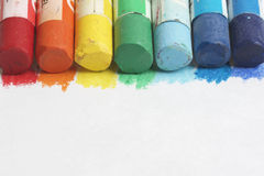 Set pastel art on a white background. Colors of rainbow. Pastel pencils are located along the upper side of the frame Royalty Free Stock Photography