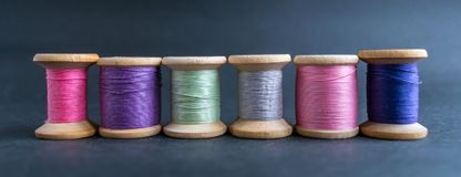 Set of pastel colors thread for sewing on a black background. Se royalty free stock photos