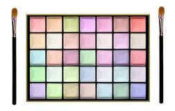 Set of pastel eyeshadows and brushes isolated on white backgroun Stock Images