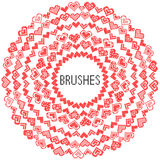 Set of pattern brushes. Embroidered hearts Stock Photos