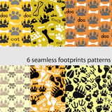 Set of patterns with footprints and bones. Vector illustration Stock Photography
